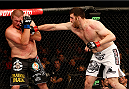 AUSTIN, TX - NOVEMBER 22:  (R-L) Ruslan Magomedov of Russia punches Josh Copeland in their heavyweight bout during the UFC Fight Night event at The Frank Erwin Center on November 22, 2014 in Austin, Texas.  (Photo by Josh Hedges/Zuffa LLC/Zuffa LLC via Getty Images)