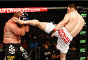 AUSTIN, TX - NOVEMBER 22:  (R-L) Ruslan Magomedov of Russia kicks Josh Copeland in their heavyweight bout during the UFC Fight Night event at The Frank Erwin Center on November 22, 2014 in Austin, Texas.  (Photo by Josh Hedges/Zuffa LLC/Zuffa LLC via Getty Images)