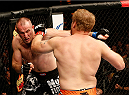 AUSTIN, TX - NOVEMBER 22:  (L-R) Alexey Oliynyk of Russia and Jared Rosholt trade punches in their heavyweight bout during the UFC Fight Night event at The Frank Erwin Center on November 22, 2014 in Austin, Texas.  (Photo by Josh Hedges/Zuffa LLC/Zuffa LLC via Getty Images)