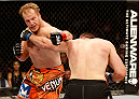 AUSTIN, TX - NOVEMBER 22:  (L-R) Jared Rosholt and Alexey Oliynyk of Russia trade punches in their heavyweight bout during the UFC Fight Night event at The Frank Erwin Center on November 22, 2014 in Austin, Texas.  (Photo by Josh Hedges/Zuffa LLC/Zuffa LLC via Getty Images)