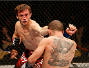 AUSTIN, TX - NOVEMBER 22:  (L-R) Brad Pickett of England punches Chico Camus in their flyweight bout during the UFC Fight Night event at The Frank Erwin Center on November 22, 2014 in Austin, Texas.  (Photo by Josh Hedges/Zuffa LLC/Zuffa LLC via Getty Images)