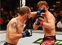 AUSTIN, TX - NOVEMBER 22:  (L-R) Chico Camus punches Brad Pickett of England in their flyweight bout during the UFC Fight Night event at The Frank Erwin Center on November 22, 2014 in Austin, Texas.  (Photo by Josh Hedges/Zuffa LLC/Zuffa LLC via Getty Images)