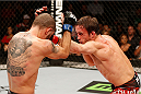 AUSTIN, TX - NOVEMBER 22:  (R-L) Brad Pickett of England punches Chico Camus in their flyweight bout during the UFC Fight Night event at The Frank Erwin Center on November 22, 2014 in Austin, Texas.  (Photo by Josh Hedges/Zuffa LLC/Zuffa LLC via Getty Images)