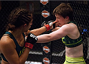 LAS VEGAS, NV - AUGUST 5:  (L-R) Team Pettis fighter Jessica Penne exchanges punches with team Pettis fighter Aisling Daly during filming of season twenty of The Ultimate Fighter on August 5, 2014 in Las Vegas, Nevada. (Photo by Brandon Magnus/Zuffa LLC/Zuffa LLC via Getty Images) *** Local Caption *** Jessica Penne;Aisling Daly