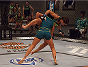 LAS VEGAS, NV - AUGUST 6:  (L-R) Team Pettis fighter Carla Esparza takes down team Pettis fighter Tecia Torres in the quarterfinals during filming of season twenty of The Ultimate Fighter on August 6, 2014 in Las Vegas, Nevada. (Photo by Brandon Magnus/Zuffa LLC/Zuffa LLC via Getty Images) *** Local Caption *** Carla Esparza;Tecia Torres