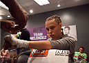 LAS VEGAS, NV - AUGUST 6:  Team Melendez fighter Rose Namajunas gets her hands wrapped before facing team Pettis fighter Joanne Calderwood in the quarterfinals during filming of season twenty of The Ultimate Fighter on August 6, 2014 in Las Vegas, Nevada. (Photo by Brandon Magnus/Zuffa LLC/Zuffa LLC via Getty Images) *** Local Caption *** Rose Namajunas