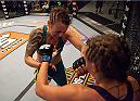 LAS VEGAS, NV - AUGUST 6:  (L-R)Team Pettis fighter Joanne Calderwood punches team Melendez fighter Rose Namajunas in the quarterfinals during filming of season twenty of The Ultimate Fighter on August 6, 2014 in Las Vegas, Nevada. (Photo by Brandon Magnus/Zuffa LLC/Zuffa LLC via Getty Images) *** Local Caption *** Joanne Calderwood;Rose Namajunas