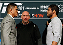 LAS VEGAS - DECEMBER 04:  (L-R) Opponents Anthony Pettis and Gilbert Melendez face off during the UFC 181 Ultimate Media Day at the MGM Grand Hotel/Casino on December 4, 2014 in Las Vegas, Nevada. (Photo by Josh Hedges/Zuffa LLC/Zuffa LLC via Getty Images)