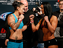 LAS VEGAS, NV - DECEMBER 05:  (L-R) Opponents Raquel Pennington and Ashlee Evans-Smith face off during the UFC 181 weigh-in inside the Mandalay Bay Events Center on December 5, 2014 in Las Vegas, Nevada.  (Photo by Josh Hedges/Zuffa LLC/Zuffa LLC via Getty Images)