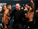 LAS VEGAS, NV - DECEMBER 05:  (L-R) Opponents Anthony Pettis and Gilbert Melendez face off during the UFC 181 weigh-in inside the Mandalay Bay Events Center on December 5, 2014 in Las Vegas, Nevada.  (Photo by Josh Hedges/Zuffa LLC/Zuffa LLC via Getty Images)
