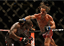 LAS VEGAS, NV - DECEMBER 06:  (R-L) Josh Samman punches Eddie Gordon in their middleweight bout during the UFC 181 event inside the Mandalay Bay Events Center on December 6, 2014 in Las Vegas, Nevada.  (Photo by Josh Hedges/Zuffa LLC/Zuffa LLC via Getty Images)