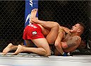 LAS VEGAS, NV - DECEMBER 06:  (R-L) Anthony Pettis submits Gilbert Melendez in their UFC lightweight championship bout during the UFC 181 event inside the Mandalay Bay Events Center on December 6, 2014 in Las Vegas, Nevada.  (Photo by Josh Hedges/Zuffa LLC/Zuffa LLC via Getty Images)