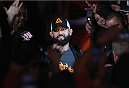 LAS VEGAS, NV - DECEMBER 06:  Johny Hendricks walks to the Octagon before his UFC welterweight championship bout during the UFC 181 event inside the Mandalay Bay Events Center on December 6, 2014 in Las Vegas, Nevada.  (Photo by Josh Hedges/Zuffa LLC/Zuffa LLC via Getty Images)