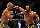 LAS VEGAS, NV - DECEMBER 06:  (R-L) Johny Hendricks punches Robbie Lawler in their UFC welterweight championship bout during the UFC 181 event inside the Mandalay Bay Events Center on December 6, 2014 in Las Vegas, Nevada.  (Photo by Josh Hedges/Zuffa LLC/Zuffa LLC via Getty Images)