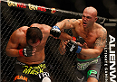LAS VEGAS, NV - DECEMBER 06:  (R-L) Robbie Lawler punches Johny Hendricks in their UFC welterweight championship bout during the UFC 181 event inside the Mandalay Bay Events Center on December 6, 2014 in Las Vegas, Nevada.  (Photo by Josh Hedges/Zuffa LLC/Zuffa LLC via Getty Images)