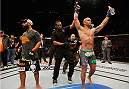 LAS VEGAS, NV - DECEMBER 06:  Robbie Lawler (right) is declred the winner over Johny Hendricks (left) in their UFC welterweight championship bout during the UFC 181 event inside the Mandalay Bay Events Center on December 6, 2014 in Las Vegas, Nevada.  (Photo by Josh Hedges/Zuffa LLC/Zuffa LLC via Getty Images)