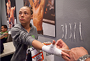 LAS VEGAS, NV - AUGUST 14:  Team Melendez fighter Rose Namajunas gets her hands wrapped before facing team Pettis fighter Randa Markos during filming of season twenty of The Ultimate Fighter on August 14, 2014 in Las Vegas, Nevada. (Photo by Brandon Magnus/Zuffa LLC/Zuffa LLC via Getty Images) *** Local Caption *** Rose Namajunas