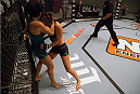 LAS VEGAS, NV - AUGUST 14:  (R-L) Team Melendez fighter Rose Namajunas pushes team Pettis fighter Randa Markos up against the cage during filming of season twenty of The Ultimate Fighter on August 14, 2014 in Las Vegas, Nevada. (Photo by Brandon Magnus/Zuffa LLC/Zuffa LLC via Getty Images) *** Local Caption *** Rose Namajunas;Randa Markos