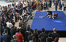 PHOENIX, AZ - DECEMBER 10:  A crowd watches as number 3-ranked UFC lightweight contender Rafael Dos Anjos (top) grapples with coach Roberto Lima during UFC Fight Night open workouts at U.S. Airways Center on December 10, 2014 in Phoenix, Arizona.  (Photo by Ralph Freso/Zuffa LLC/Zuffa LLC via Getty Images)