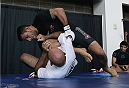 PHOENIX, AZ - DECEMBER 10:  Number 3-ranked UFC lightweight contender Rafael Dos Anjos (top) grapples with coach Roberto Lima during UFC Fight Night open workouts at U.S. Airways Center on December 10, 2014 in Phoenix, Arizona.  (Photo by Ralph Freso/Zuffa LLC/Zuffa LLC via Getty Images)