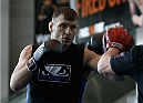 PHOENIX, AZ - DECEMBER 10:  Number 4-ranked UFC heavyweight contender Stipe Miocic throws a punch during UFC Fight Night open workouts at U.S. Airways Center on December 10, 2014 in Phoenix, Arizona.  (Photo by Ralph Freso/Zuffa LLC/Zuffa LLC via Getty Images)