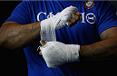 PHOENIX, AZ - DECEMBER 10:  Number 2-ranked UFC heavyweight contender Junior Dos Santos wraps his hands before UFC Fight Night open workouts at U.S. Airways Center on December 10, 2014 in Phoenix, Arizona.  (Photo by Ralph Freso/Zuffa LLC/Zuffa LLC via Getty Images)