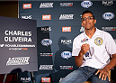 LAS VEGAS, NEVADA - DECEMBER 10:  Charles Oliveira speaks with the media during The Ultimate Fighter Finale Ultimate Media Day at the Palms Casino Resort on December 10, 2014 in Las Vegas, Nevada. (Photo by Brandon Magnus/Zuffa LLC/Zuffa LLC via Getty Images)