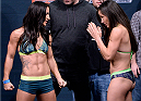 LAS VEGAS, NEVADA - DECEMBER 11:  (L-R) UFC strawweights Tecia Torres and Angela Magana face off during The Ultimate Fighter Finale weigh-ins at the Palms Casino Resort on December 11, 2014 in Las Vegas, Nevada. (Photo by Jeff Bottari/Zuffa LLC/Zuffa LLC via Getty Images)