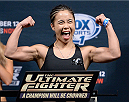 LAS VEGAS, NEVADA - DECEMBER 11:  UFC strawweight Seohee Ham steps on the scale during The Ultimate Fighter Finale weigh-ins at the Palms Casino Resort on December 11, 2014 in Las Vegas, Nevada. (Photo by Jeff Bottari/Zuffa LLC/Zuffa LLC via Getty Images)