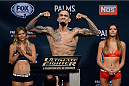 LAS VEGAS, NEVADA - DECEMBER 11:  UFC lightweight Yancy Medeiros steps on the scale during The Ultimate Fighter Finale weigh-ins at the Palms Casino Resort on December 11, 2014 in Las Vegas, Nevada. (Photo by Jeff Bottari/Zuffa LLC/Zuffa LLC via Getty Images)