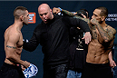 LAS VEGAS, NEVADA - DECEMBER 11:  (L-R) Joe Proctor and Yancy Medeiros are separated by UFC President Dana White as they face off during The Ultimate Fighter Finale weigh-ins at the Palms Casino Resort on December 11, 2014 in Las Vegas, Nevada. (Photo by Jeff Bottari/Zuffa LLC/Zuffa LLC via Getty Images)