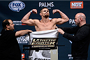LAS VEGAS, NEVADA - DECEMBER 11:  UFC lightweight Daron Cruickshank steps on the scale during The Ultimate Fighter Finale weigh-ins at the Palms Casino Resort on December 11, 2014 in Las Vegas, Nevada. (Photo by Jeff Bottari/Zuffa LLC/Zuffa LLC via Getty Images)