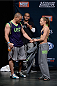 LAS VEGAS, NEVADA - DECEMBER 11:  (L-R) Pat Barry and Rose Namajunas walk onstage during The Ultimate Fighter Finale weigh-ins at the Palms Casino Resort on December 11, 2014 in Las Vegas, Nevada. (Photo by Jeff Bottari/Zuffa LLC/Zuffa LLC via Getty Images)