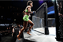 LAS VEGAS, NEVADA - DECEMBER 12: Angela Hill prepares to enter the Octagon before facing Emily Kagan in their strawweight fight during The Ultimate Fighter Finale event inside the Pearl concert theater at the Palms Casino Resort on December 12, 2014 in Las Vegas, Nevada. (Photo by Jeff Bottari/Zuffa LLC/Zuffa LLC via Getty Images)