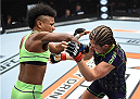 LAS VEGAS, NEVADA - DECEMBER 12: (L-R) Angela Hill punches Emily Kagan in their strawweight fight during The Ultimate Fighter Finale event inside the Pearl concert theater at the Palms Casino Resort on December 12, 2014 in Las Vegas, Nevada. (Photo by Jeff Bottari/Zuffa LLC/Zuffa LLC via Getty Images)