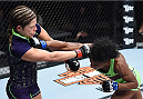 LAS VEGAS, NEVADA - DECEMBER 12: (R-L) Angela Hill punches Emily Kagan in their strawweight fight during The Ultimate Fighter Finale event inside the Pearl concert theater at the Palms Casino Resort on December 12, 2014 in Las Vegas, Nevada. (Photo by Jeff Bottari/Zuffa LLC/Zuffa LLC via Getty Images)
