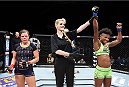 LAS VEGAS, NEVADA - DECEMBER 12: (R-L) Angela Hill celebrates her victory over Emily Kagan in their strawweight fight during The Ultimate Fighter Finale event inside the Pearl concert theater at the Palms Casino Resort on December 12, 2014 in Las Vegas, Nevada. (Photo by Jeff Bottari/Zuffa LLC/Zuffa LLC via Getty Images)