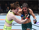 LAS VEGAS, NEVADA - DECEMBER 12:  (R-L) Alex Chambers elbows Aisling Daly in their strawweight fight during The Ultimate Fighter Finale event inside the Pearl concert theater at the Palms Casino Resort on December 12, 2014 in Las Vegas, Nevada. (Photo by Jeff Bottari/Zuffa LLC/Zuffa LLC via Getty Images)