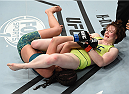 LAS VEGAS, NEVADA - DECEMBER 12:  (R-L) Aisling Daly attempts to submit Alex Chambers in their strawweight fight during The Ultimate Fighter Finale event inside the Pearl concert theater at the Palms Casino Resort on December 12, 2014 in Las Vegas, Nevada. (Photo by Jeff Bottari/Zuffa LLC/Zuffa LLC via Getty Images)