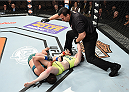 LAS VEGAS, NEVADA - DECEMBER 12:  (R-L) Aisling Daly submits Alex Chambers in their strawweight fight during The Ultimate Fighter Finale event inside the Pearl concert theater at the Palms Casino Resort on December 12, 2014 in Las Vegas, Nevada. (Photo by Jeff Bottari/Zuffa LLC/Zuffa LLC via Getty Images)