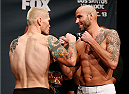PHOENIX, AZ - DECEMBER 12:  (L-R) Opponents Joe Riggs and Ben Saunders face off during the UFC Fight Night weigh-in event at the Phoenix Convention Center on December 12, 2014 in Phoenix, Arizona. (Photo by Josh Hedges/Zuffa LLC/Zuffa LLC via Getty Images)