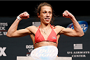 PHOENIX, AZ - DECEMBER 12:  Joanna Jedrzejczyk of Poland poses on the scale after weighing in during the UFC Fight Night weigh-in event at the Phoenix Convention Center on December 12, 2014 in Phoenix, Arizona. (Photo by Josh Hedges/Zuffa LLC/Zuffa LLC via Getty Images)