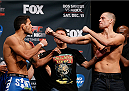 PHOENIX, AZ - DECEMBER 12:  (L-R) Opponents Rafael dos Anjos of Brazil and Nate Diaz face off during the UFC Fight Night weigh-in event at the Phoenix Convention Center on December 12, 2014 in Phoenix, Arizona. (Photo by Josh Hedges/Zuffa LLC/Zuffa LLC via Getty Images)