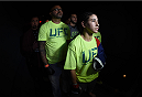 LAS VEGAS, NEVADA - DECEMBER 12:  Tecia Torres prepares to enter the Octagon before facing Angela Magana in their strawweight fight during The Ultimate Fighter Finale event inside the Pearl concert theater at the Palms Casino Resort on December 12, 2014 in Las Vegas, Nevada. (Photo by Jeff Bottari/Zuffa LLC/Zuffa LLC via Getty Images)
