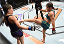 LAS VEGAS, NEVADA - DECEMBER 12:  (R-L) Tecia Torres kicks Angela Magana in their strawweight fight during The Ultimate Fighter Finale event inside the Pearl concert theater at the Palms Casino Resort on December 12, 2014 in Las Vegas, Nevada. (Photo by Jeff Bottari/Zuffa LLC/Zuffa LLC via Getty Images)