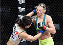 LAS VEGAS, NEVADA - DECEMBER 12: (L-R) Seohee Ham punches Joanne Calderwood in their strawweight fight during The Ultimate Fighter Finale event inside the Palms Casino Resort on December 12, 2014 in Las Vegas, Nevada. (Photo by Jeff Bottari/Zuffa LLC/Zuffa LLC via Getty Images)