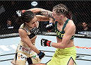 LAS VEGAS, NEVADA - DECEMBER 12: (R-L) Joanne Calderwood exchanges punches with Seohee Ham in their strawweight fight during The Ultimate Fighter Finale event inside the Palms Casino Resort on December 12, 2014 in Las Vegas, Nevada. (Photo by Jeff Bottari/Zuffa LLC/Zuffa LLC via Getty Images)