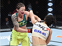 LAS VEGAS, NEVADA - DECEMBER 12: (R-L) Seohee Ham punches Joanne Calderwood in their strawweight fight during The Ultimate Fighter Finale event inside the Palms Casino Resort on December 12, 2014 in Las Vegas, Nevada. (Photo by Jeff Bottari/Zuffa LLC/Zuffa LLC via Getty Images)