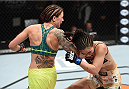 LAS VEGAS, NEVADA - DECEMBER 12: (L-R) Joanne Calderwood lands a spinning back elbow on Seohee Ham in their strawweight fight during The Ultimate Fighter Finale event inside the Palms Casino Resort on December 12, 2014 in Las Vegas, Nevada. (Photo by Jeff Bottari/Zuffa LLC/Zuffa LLC via Getty Images)