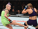 LAS VEGAS, NEVADA - DECEMBER 12: (L-R) Bec Rawlings kicks Heather Jo Clark in their strawweight fight during The Ultimate Fighter Finale event inside the Pearl concert theater at the Palms Casino Resort on December 12, 2014 in Las Vegas, Nevada. (Photo by Jeff Bottari/Zuffa LLC/Zuffa LLC via Getty Images)
